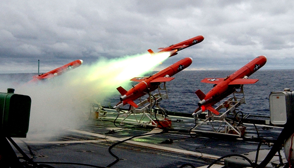 Four BQM-74E target drones launch from the USS Cowpens